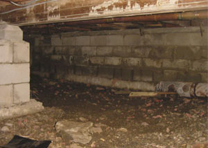 Rotting, decaying crawl space wood damaged over time in