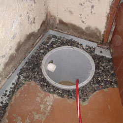Installing a sump in a sump pump liner in a Santa Barbara home