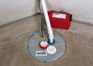 A sump pump system with a battery backup system installed in
