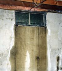 Flooding through basement windows in a  home.