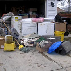 Soaked, wet personal items sitting in a driveway, including a washer and dryer in Moorpark.